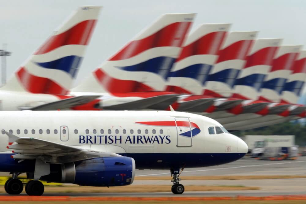 A British Airways aircraft taxis past other parked British Airways aircraft at Terminal 5 of Heathrow Airport in west London, on July 30, 2010. British Airways said on Friday its net losses widened to 122 million pounds in its first quarter as strike action and the volcanic ash cloud grounded flights but insisted it was set to break even. BA, which is looking to merge with Spain's Iberia, said losses after tax rose 15 percent to the equivalent of 146 million euros or 191 million dollars in the three months to June compared with a year earlier. AFP PHOTO/ BEN STANSALL (Photo credit should read BEN STANSALL/AFP/Getty Images)